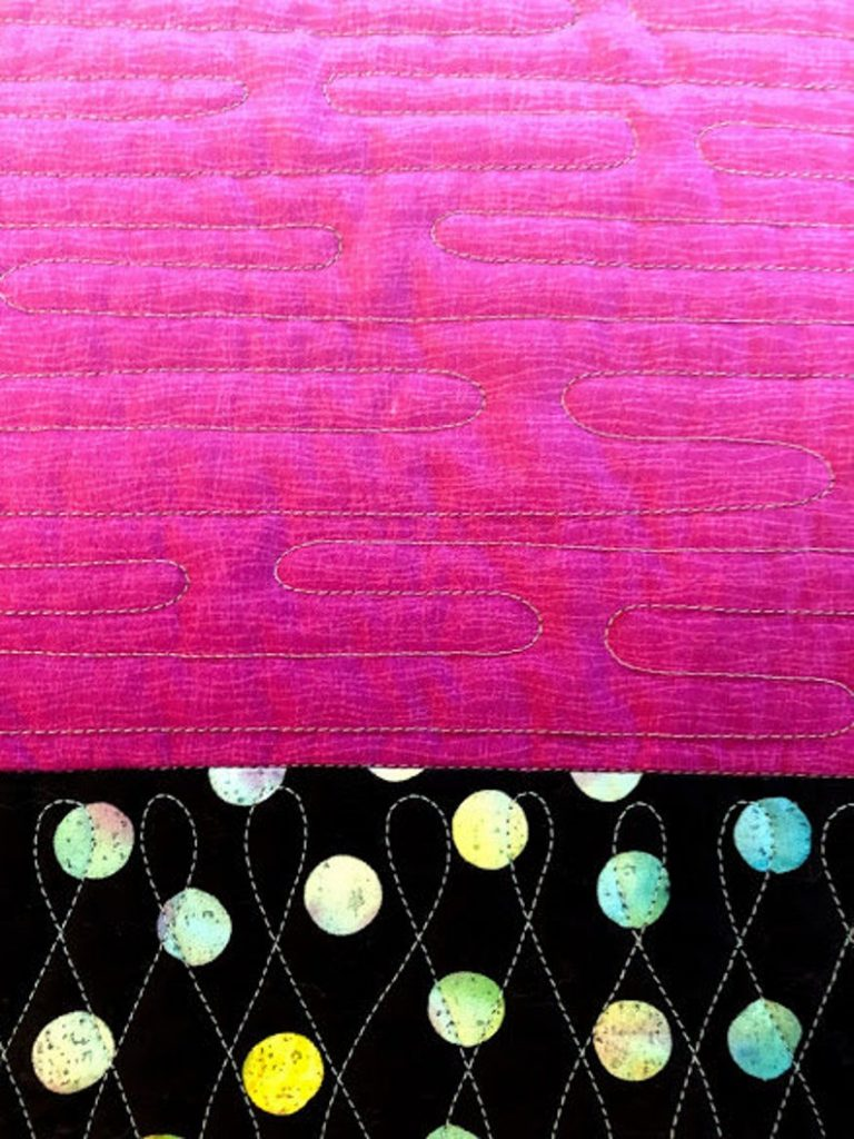Shows beautiful workmanship in close up pink and black multicolored dot sample quilted wall hanging by Ritu Haldar that makes selling quilts on Etsy easy