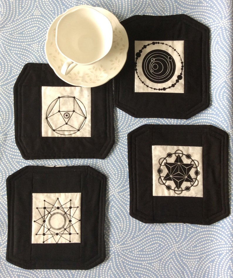 Selling quilts on Etsy is a breeze with this STEM-inspired mug rugs in Black and Cream
