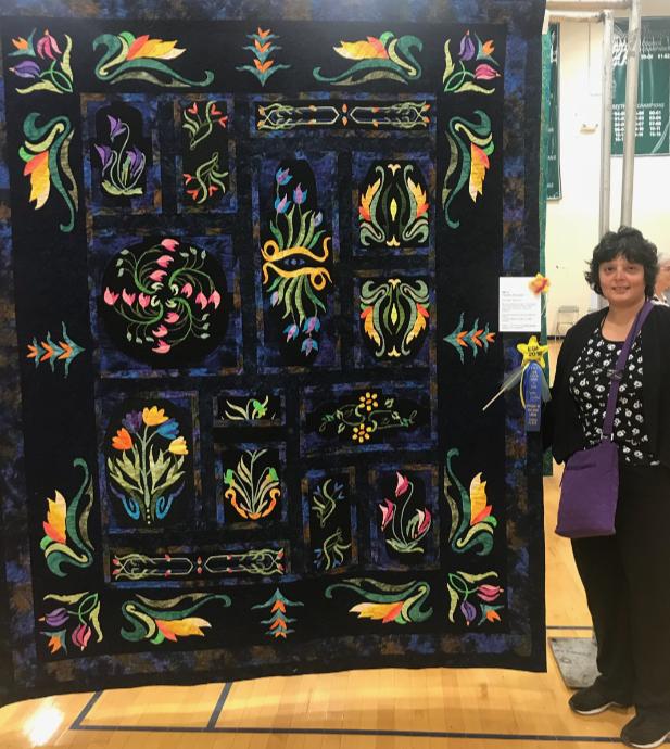 Ritu Haldar with her award-winning quilt