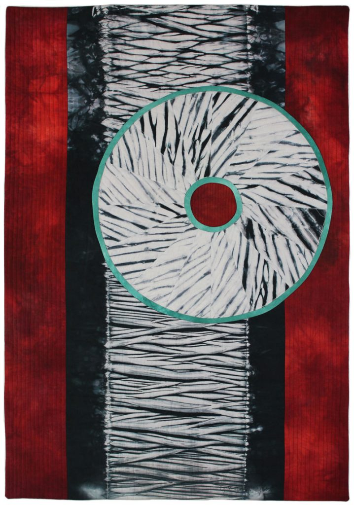 Shows art quilt that Lyric Kinard uses to make money as a quilting teacher