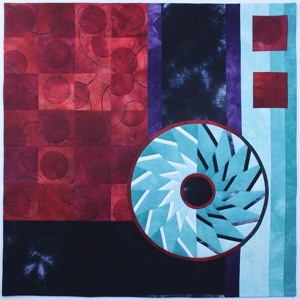 Mill Wheels VII: order & chaos Art quilt by Lyric Montgomery Kinard shows an example of the type of quilting Lyric is teaching
