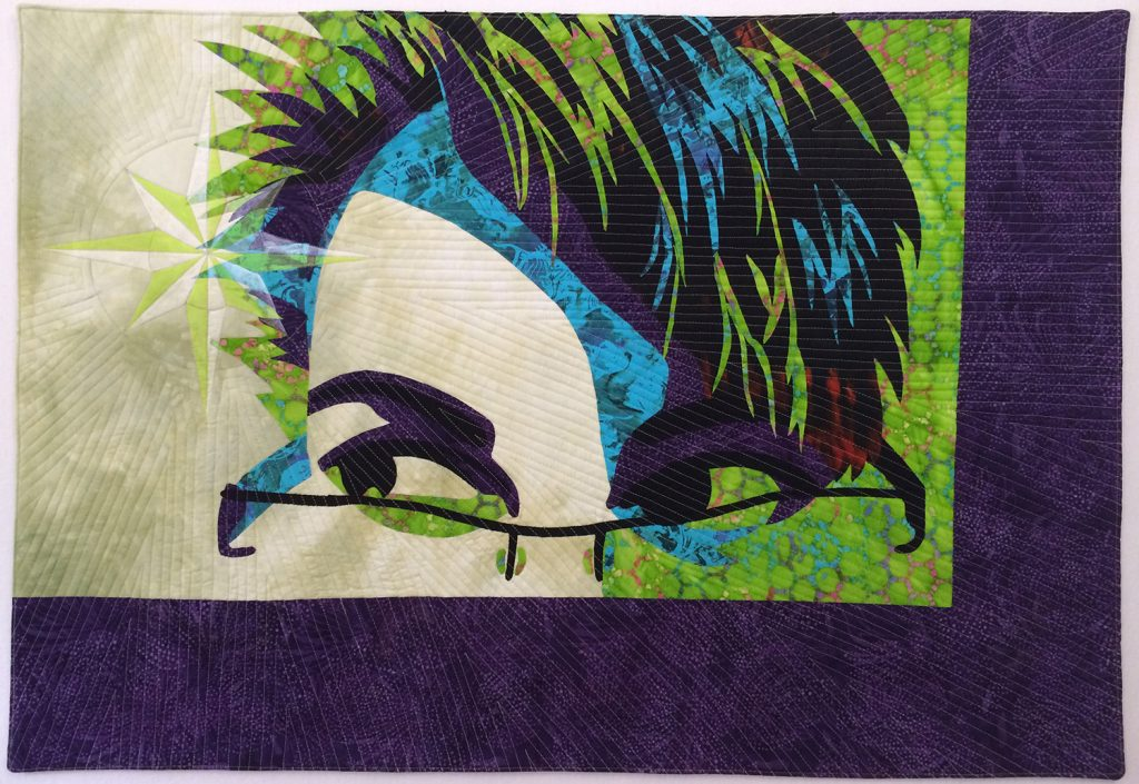Small art quilt created by Lyric Kinard while teaching quilting online