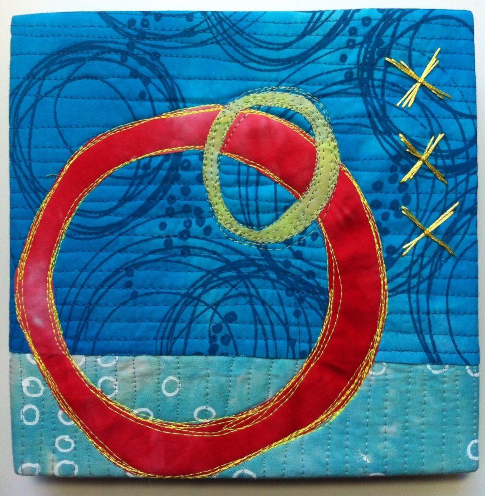 Example of an art quilt that helps Lyric Kinard make money as a quilt teacher